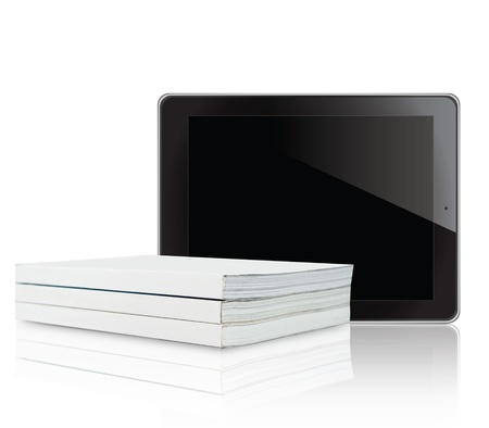 Book and tablet computer on white background photo