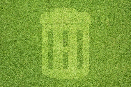 Trash on green grass texture and  background