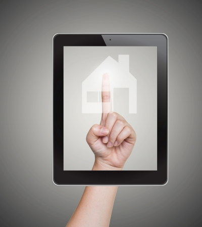 Hand pushing home button of tablet on a touch screen Standard-Bild