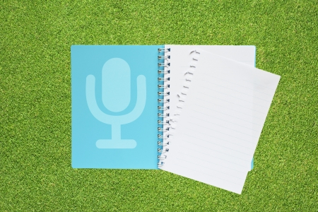 Microphone with music on grass background  photo