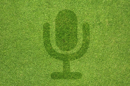 Microphone icon on green grass texture and  background photo