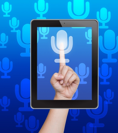 Hand pushing microphone button of tablet on a touch screen photo