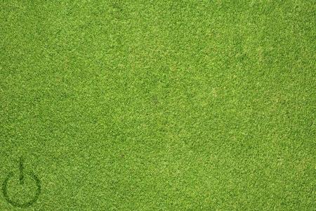 shutdown: Shutdown icon on green grass texture and  background Stock Photo