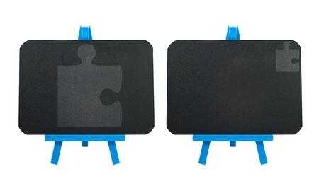 Jigsaw icon on blank blackboard background photo