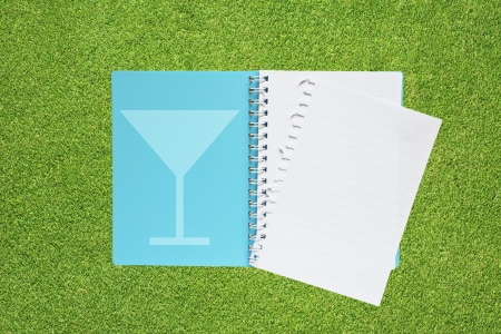 Book with drink icon on grass background  photo