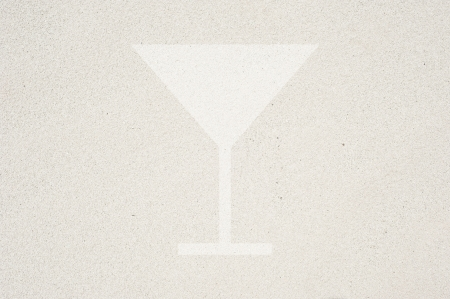 Drink icon on sand background and textured Stock Photo