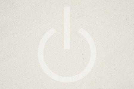 shutdown: Shutdown icon on sand texture and background  Stock Photo