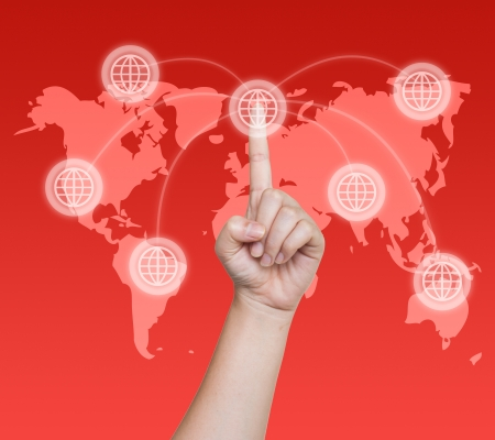 Hand pushing global button on a touch screen interface  Stock Photo