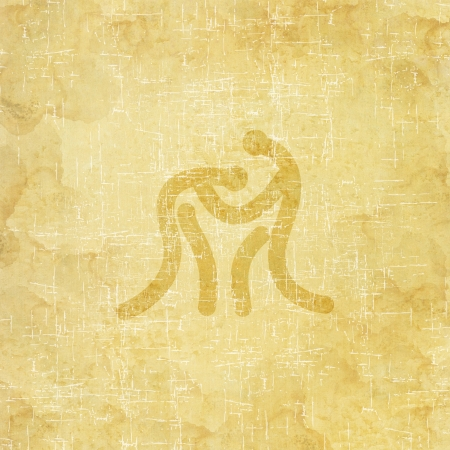 Sport wrestling icon on old paper background and textured photo