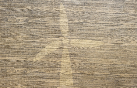 Wind turbine on wood texture and background  photo