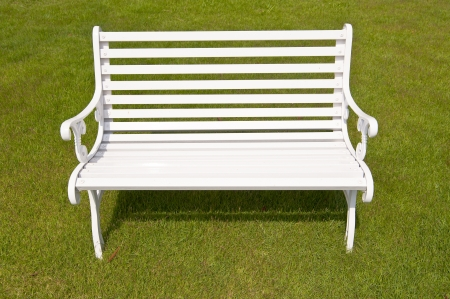 White bench on grass background photo