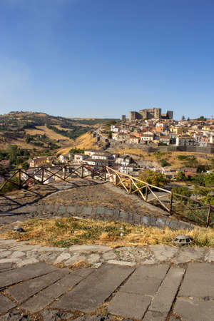 Skyline of Melfi. Skyline of Melfi (basilicata) during a summer day. It is possible to see the wheat fields and a medieval castle in the background with a sunny clear sky