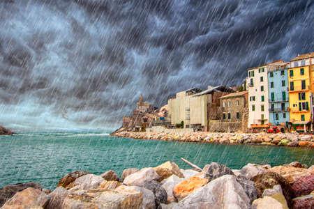 Rain couldy storm on Portovenere (Porto Venere) in Liguria, Italy: scenic view of the Church of St. Peter (Chiesa di San Pietro) from coast 新聞圖片