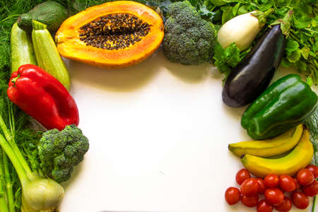 Healthy food clean eating selection: fruit, vegetable, papaya, superfood, leaf vegetable on white background