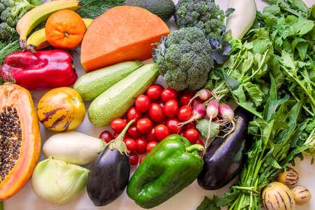 Healthy food clean eating selection: fruit, vegetable, papaya, superfood, leaf vegetable on white background Archivio Fotografico