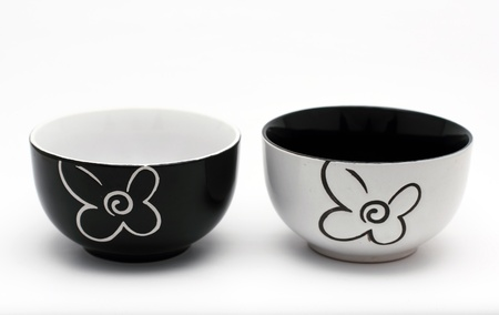 housewares: Two black and white porcelain bowls on a white background Stock Photo