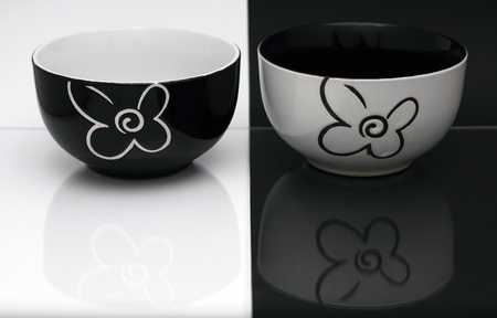 housewares: Two black and white porcelain bowls on a black and white background