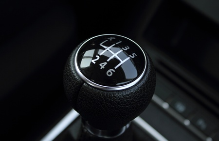 levers: black handle of a transmission of the car Stock Photo