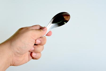 aluminium: Hand holding short aluminium spoon, Thai central spoon Stock Photo
