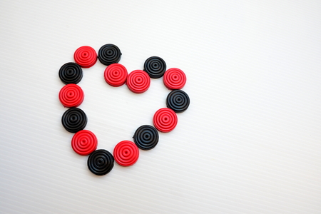 checkers: Heart sign from checkers game Stock Photo