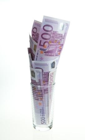 geld in een glas Stockfoto