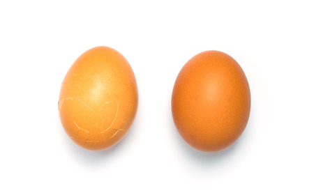 aligning: 2 Eggs aligning on white background. one is cracked