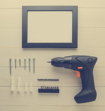 driller: Picture Photo Frame Driller Installation Set. Stock Photo