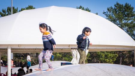 japanese children: Fukuoka, Japan - Japanese Children in having fun in public playground.