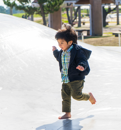 japanese children: Fukuoka, Japan -Japanese Children in having fun in public playground.