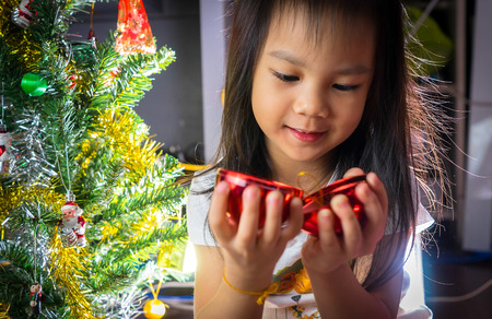 miracle tree: Little Asian Girl is Decoration Christmas Tree
