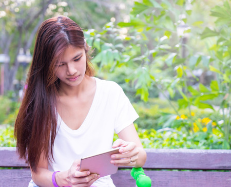 e reading: Asian Girl is reading Tablet E book