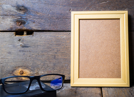 holiday movies: Wooden Picture Frame and Glasses Stock Photo