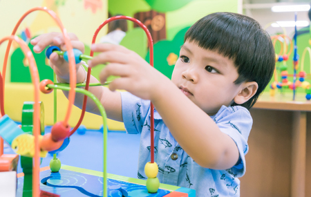 Asian Baby playing with Educational toy