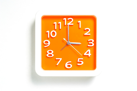 Orange Wall clock counting at 3