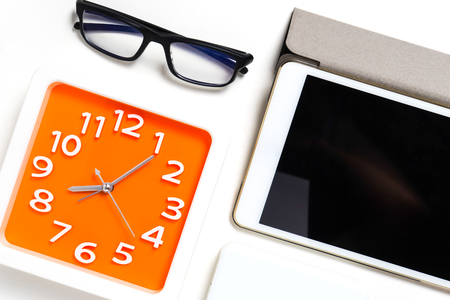 blank tablet: Orange Clock Glasses and Tablet blank screen Stock Photo