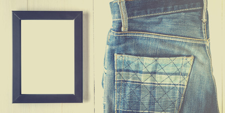 vintage photo: Blank Photo frame with vintage jeans Stock Photo