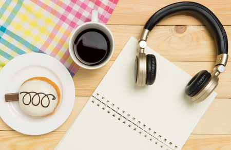 Music and Writing relaxation in Cafe with copy space notebook Stock Photo
