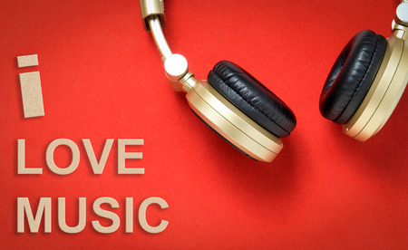 love music: I love Music Golden Text with headphone on red background