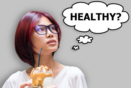 Japanese girl asking her self if the Food eating is healthy or not. Stock Photo
