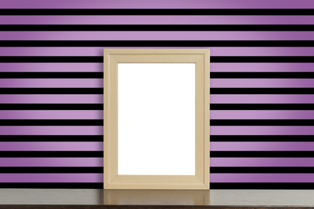 room accent: Wooden Picture frame on pink and black punk style stripe wall Stock Photo