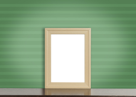 home accent: Blank wooden photo frame on green stripe background.