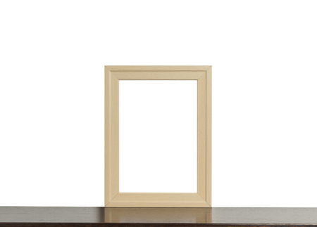 room accents: Wooden photo frame on shelf isolated on white