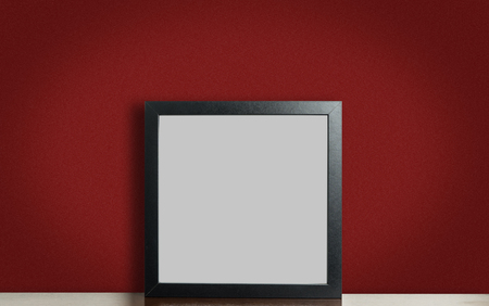 room accent: Think black photo frame on red background
