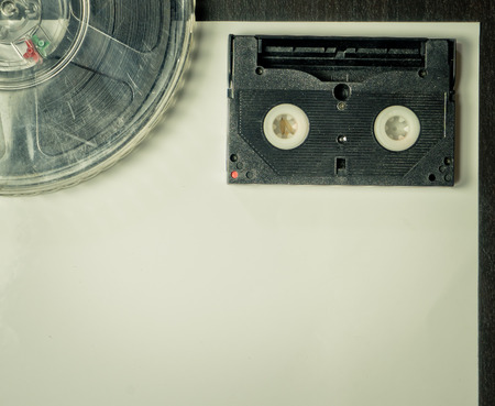 videocassette: Film and Video Cassette on vintage paper background