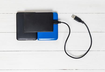 external: USB External Hard disks on wooden background