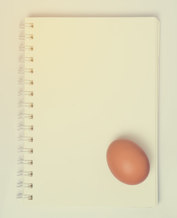 book binding: An Egg on a Blank Note book binding page