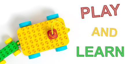 children at play: Children play and learn colorful toy Stock Photo