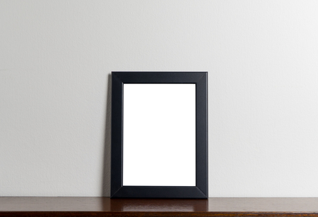room accents: Black modern picture frame on gray background. Black photo frame made of paper on a white cement background.