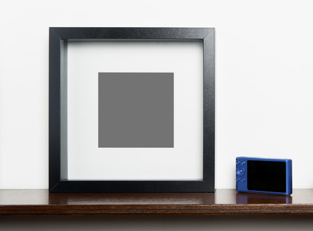 compact camera: Blank photo frame with compact camera for memory picture