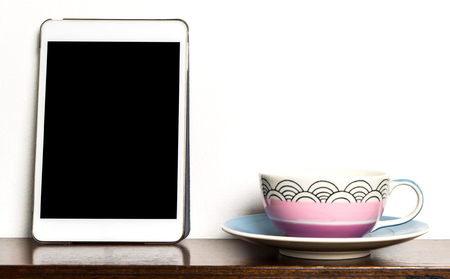 blank tablet: Blank tablet frame with Ceramic tea cup Stock Photo